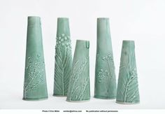 ceramic vases.  Lisa Firer:  A group of bud vases with examples of Cape fynbos, suitable for  displaying plant sprigs.