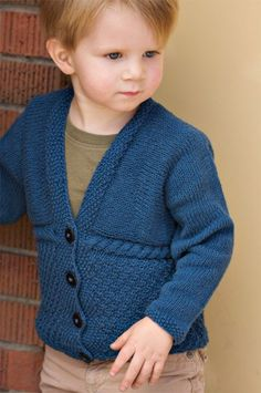 Free knitting pattern for Ewan Cardigan -Sarah Grieve of Petite Purls designed this cardigan in baby and children sizes 6-12 months [18-24 months, 2-3 years, 4 years, 5 years]. It is knit sideways in two parts.