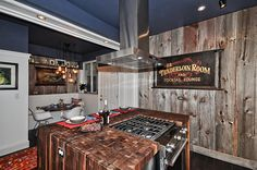 4502 N Magnolia Unit 1N Sheridan Park - Uptown - Chicago, Illinois - Christian Schaller, Johnson Roberts Associates Architects Inc. 2015 For sale @ $485,000  Kitchen: Black Walnut Butcher block Waterfall edge from John Boos Effingham, IL. Old Tavern Signs, Retro Bar Stools, reclaimed Barnwood Walls, Hickory Flooring. Ikea White Cabinets, Ben Moore newburyport blue HC 155 Ceilings, Pure White walls and trim. Reclaimed Barnwood Shelving, Danby Vermont White Marble Counters.