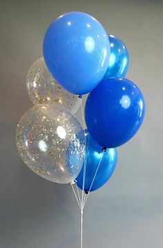 Celebrate with a beautiful blues balloon bouquet! Balloon bouquet includes six 11 inch balloons: 4 richly saturated blues- Pearl Sapphire, Periwinkle Blue and Dark Blue 2 Gold Glam confetti balloons Add String and a Weight! 6 Pre-cut 4 foot white twine strings. Gold Cube Weight