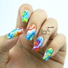 Watercolour rainbow nails —>