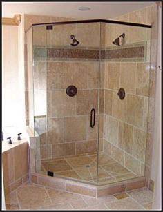 Corner shower stall with tile and glass...