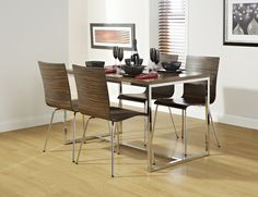 The Madison  5 piece dining set  comfortably seats 4 people at the table. The table top and chairs finished in an ebony effect with chrome effect legs to give you that modern look in your dining room or kitchen. £330