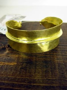 And heart this gold Harper Modern Vintage Carolyn Cuff for $72 also at scoutandmollys.com