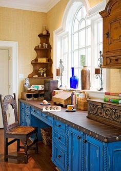 Rustic.  Love the blue shade on the cabinets. Office space?