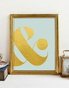 Gold ampersand on a soft blue background, a nice soft classy look to add to any room. Printable art.