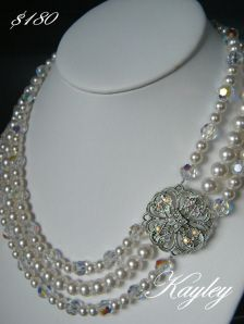 Love the broach detail to these strands of pearls from Pink Tiara....
