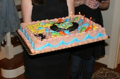40th birthday, retro, Building Future through lens of past.  The cake continued the theme--with a record (#40 in center of record) and day glo colors to decorate.  Used colored flame candles.