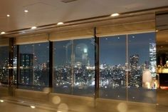 Windows with a view.  Lights placed around the window emphasize them