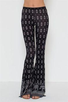 Aztec black and white print bell bottom pants with elephant design at hem #SoleMioLosAngeles #Bellbottompants