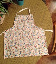My latest project was an apron for my friends toddler. You may need to zoom to see the pattern of kitchen utensils clearly.