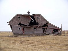 Collapsing Barn, photographed in western McIntosh County, ND, just a few miles West of Wishek.  Very sad  :(