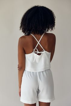 This white top is slightly cropped, has a high square neckline and tie-straps in the back to adjust the fit. Wear it with or without a bra (it is strapless-bra-friendly) and pair it with our Basic Shorts. Fabric: 100% TENCEL™ fibers from Austria, woven in Spain and sustainably dyed using the Iris method. Made in Germany The Slow Label SS20 collection Basic Shorts, Square Necklines, Crop Tank, White Tops, Organic Cotton, Bra, My Style, How To Wear, Austria