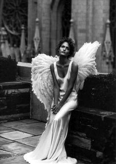 Amber Valletta photographed by Peter Lindberg.     #wings #feather #feathers #angel #angels #beautiful #vogue #fashion #stunning #bw #model #photoshoot #dreamy #celestial #godlike #church #heaven #earth #bw #think #feel #pensive #dream #daydream #believe #wonder #awe #fashion #photography #sit #model #angelic #being #cherub #feathered #fly #protect #strength #protection