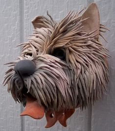 Douglas Fey Pottery.  From dragons to dogs they're all cool.  They're also all bird houses!