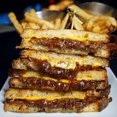 Stacks of short rib grilled cheese from @properwest. I'm not usually a grilled cheese fan...I know try to hold back the angry shouts but this slow-cooked BBQ addition was on point. What's the best grilled cheese you've ever had? . . . #happyplate #shortribs #shortrib #grilledcheesesandwich #sandwichporn #eatfortheinsta #eatingfortheinsta #feastagram #foodpornography #foodstyle #eat #barfood #cheeseplease  #nycdining #nyceats #nyceeeeeats #gooey #ribsandburgers #instalover #yum #foodie…