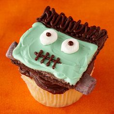 Freak out the crowd with this spooky Frankenstein cupcake: http://www.bhg.com/halloween/recipes/17-frightfully-good-halloween-cupcakes/?socsrc=bhgpin083014grahamcrackercupcakes&page=40