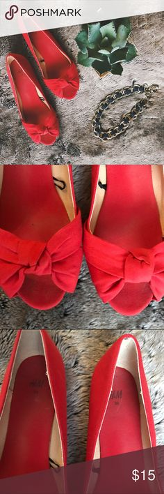 H&M red open toe bow flats Super cute red flats from H&M with a bow design and an open toe. Inside and sole have some wear (pictured) but the outside of the shoe is clean. Fabric has a crisp linen feel - perfect with a sundress or dress them up for work! H&M Shoes Flats & Loafers
