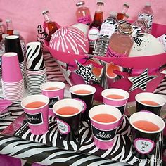 Decorate a big pink party tub with star cutouts to add cute DIY details at the drink station.