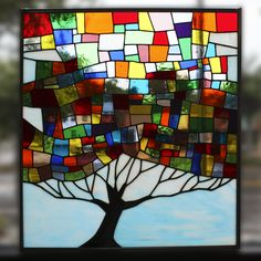 This stained glass tree is absolutely spectacular! An original design by one of the best artisans at Grand Central Stained Glass in St. Petersburg, Florida!