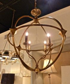 Brass Ballario orb chandelier by Curry and Company. High Point Market Spring 2014 Finds We Love at Design Connection, Inc. | Kansas City Interior Design #HPMkt #HPMkt2014 #InteriorDesign http://www.DesignConnectionInc.com/Blog