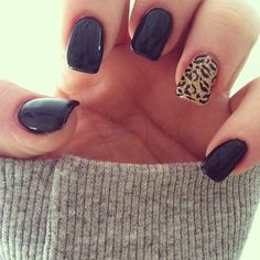 Black nails with a leopard accent nail