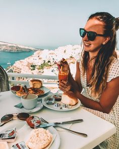"Iris 🌸 Travel & Style on Instagram: ""the most perfect place to have breakfast at. 💙🇬🇷 Gosh, looking through my photos of Santorini makes me realize how much I miss this island!…"" I Missed, Santorini, Travel Style, Perfect Place, Iris, My Photos, Island, Breakfast, Places"