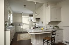 """In this remodel of a house built over a century ago, our clients craved """"front of house"""" details to bring richness to the kitchen they use every day."""