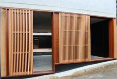 Timber shutters, sliding shutters, sliding glass doors, concrete house extension and renovation, architectural timber details, black walls, Newtown, NSW - askerrobertson design