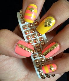 DIY Nail art for short nails! I'm in love with my mani!! Yellow and coral with studs.