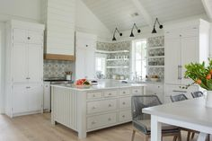 Classic white coastal cottage kitchen in Palmetto Bluff by Lisa Furey. Modern farmhouse design elements include floating shelves, shiplap, white oak flooring, and apron front farm sink. Modern Farmhouse Interiors, Modern Farmhouse Design, Cottage Interiors, Modern Farmhouse Kitchens, Kitchen Modern, White Cottage Kitchens, Coastal Cottage, Coastal Style, Cottage Entryway