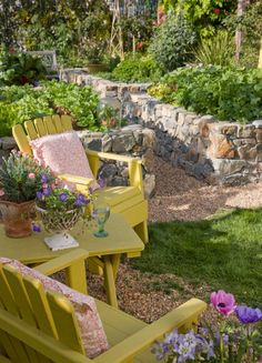 Charming garden spot.  Love those yellow chairs!