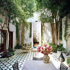 Los Feliz, CA residence designed by Ramin and Pamela Shamshiri featured in Vogue, May, 2013. The garden walls were raised to seven feet and planters were placed on top to give a sense of a sunken courtyard. Ceramic fireplace by #StanBitters | Custom made cement tiles | Matthew Brown landscape design | Photo by #FrançoisHalard. #pamelashamshiri