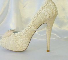 Lacey Ivory wedding shoes ..  with 5 1/4 heels and shabby chic rosette on toes. $255.00, via Etsy.