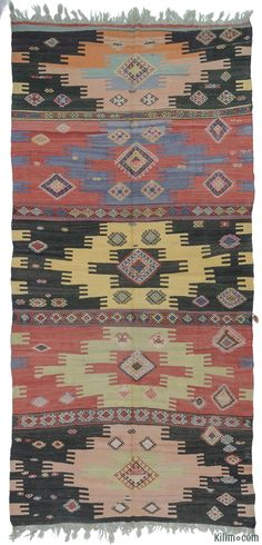 Vintage tribal Turkish kilim rug around 60 years old and in very good condition. This kilim was hand-woven in the Sivas region of Central Anatolia, Turkey.