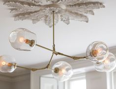 At Home: Cool and Neutral May 2019 Hanging Light Fixtures, Modern Light Fixtures, Hanging Lights, Bubble Chandelier, Ceiling Chandelier, Ceiling Lights, Modern Chandelier, Chandeliers, Modern Ceiling Medallions