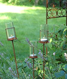 Lovely rustic garden lights available in the boutique...