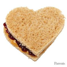 Dad of Amanda, 6, and Max, 3; guest judge on Food Network's Chopped; and executive chef of Lure Fishbar and B&B Winepub, in New York PB&J heart-shaped sandwich on whole-wheat bread Baby carrots Banana with silly sticker