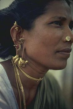 India |  Portrait of a village woman, with her lovely jewellery.  Photo taken in Madurai, Tamil Nadu. | Photographer unknown