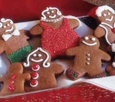 GINGERBREAD PEOPLE:  ■16 Tbs. (2 sticks) unsalted butter, at room temperature   ■½ cup firmly packed light brown sugar   ■½ cup granulated sugar   ■1 cup light molasses   ■1 egg   ■5 cups all-purpose flour   ■1 tsp. baking soda   ■1 Tbs. ground ginger   ■1 tsp. ground cinnamon   ■½ tsp. ground cloves   ■½ tsp. salt    ■Royal icing for decorating  Colored sugars and other decorations as desired