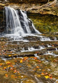 Water cascades over the Canyon Falls and past colorful autumn leaves in Indiana's McCormick's Creek State Park. (Photo: Kenneth Keifer)