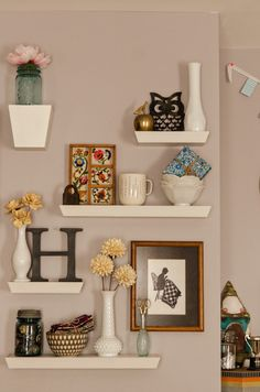 Have fun with shapes and angles when you group shelves of different sizes into a pretty, 3D wall collage. See more at Bijou Lovely »