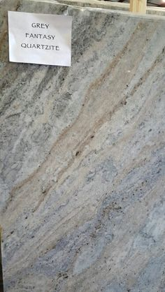 Grey Fantasy quartzite kitchen and bathroom countertops at Ecstatic Stone in Columbia, South Carolina. #kitchen #bath #quartzitecountertops #kitchenideas