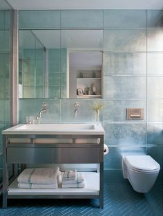 silvery blue  modern bathroom with herringbone floor tile, silver wall tile, photographer Peter Margonelli