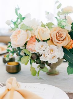 Sweetest peach centerpiece. #wedding #reception