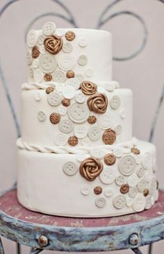 offset white wedding cake with sugar flowers and buttons