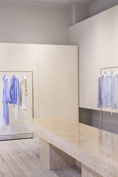 Studio David Thulstrup designs minimalist boutique for Mark Kenly Domino Tan - Dr Wong - Emporium of Tings. Metal Clothes Rack, Grey Painted Walls, Best Interior, Interior Design, Daybed Covers, Glass Brick, Danish Fashion, Custom Made Clothing, Showroom Design