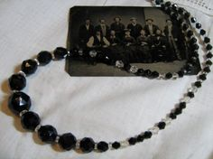 Jet Black and Clear  Crystal Antique Faceted Bead Necklace. $30.00, via Etsy.