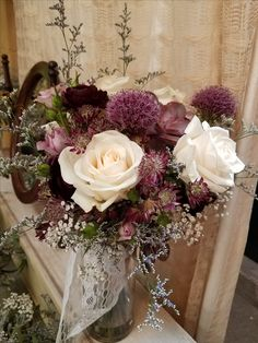 Wedding bouquet - mauves, creams, and burgundies.