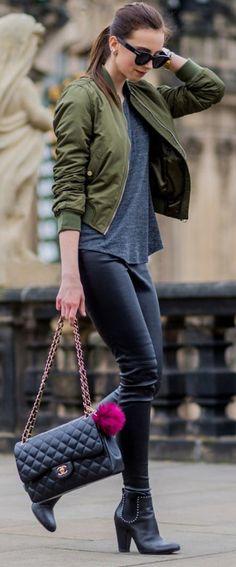 Barbora Ondrackova + khaki bomber + casual style + leather trousers + plain grey tee  Jacket: Topshop, Top: Mango, Leggings: Balenciaga, Boots: Givenchy.